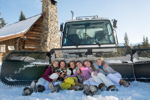 cat skiing group of girls