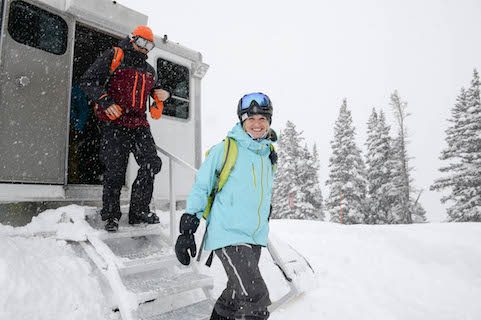girl exiting snow cat