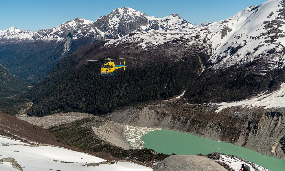 Eleven Experience helicopter flying over Andes Mountains and other Patagonia landscapes