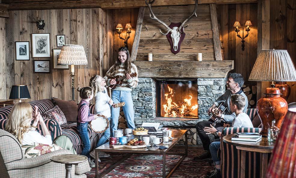 Family Enjoying the Chalet Hibou Living Room