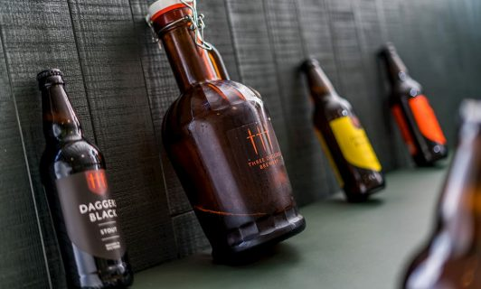 three daggers brewery bottles and growler