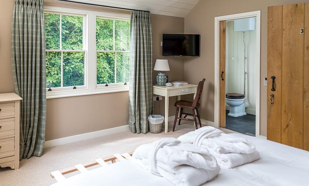 hillside cottage bed and bathroom
